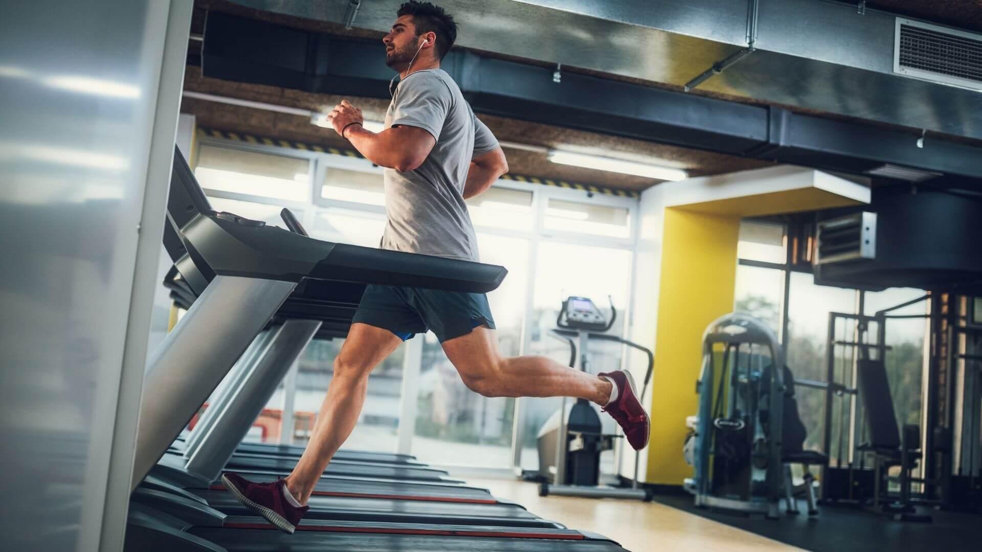 Man running on treadmill at Gym Plu